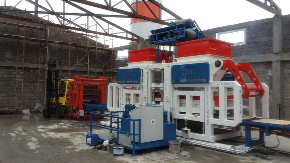 Bess interlocking block machine